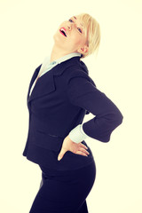 Mature business woman with backpain