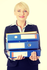 Happy mature business woman's holding documents