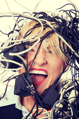 Mature businesswoman's screaming in cables