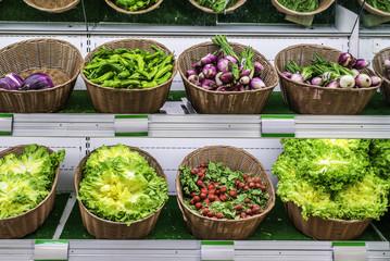 Fruits and vegetables on a supermarket shelf