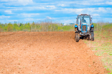 tractor plowed field in spring