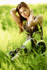 Woman sitting in a green field