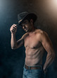 canvas print picture - Sexy cowboy with smoky background