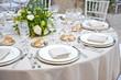 Leinwanddruck Bild - A table set for a reception