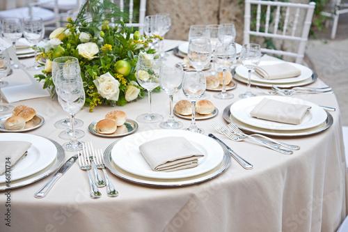 Leinwanddruck Bild A table set for a reception