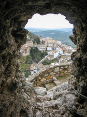 View of the white city through an embrasure of  ancient castle