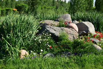 An attractive flowerbed with some rock
