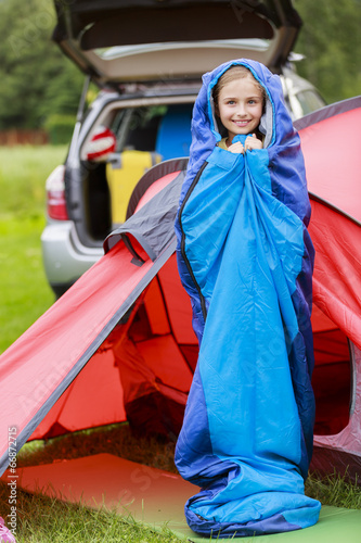 Camp in the tent - young girl on the camping