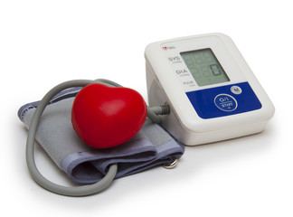 Digital blood pressure meter on white background
