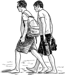 guys walking on a beach
