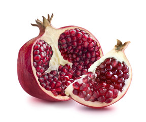 Half of pomegranate and quarter slice isolated on white backgrou