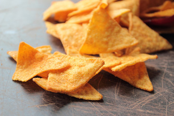 Spicy nachos chips for appetizer on a wooden table