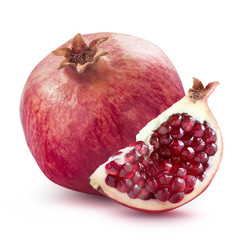Whole pomegranate and quarter slice isolated on white background
