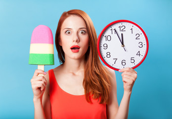 Redhead girl with toy ice cream and huge clock on blue backgroun