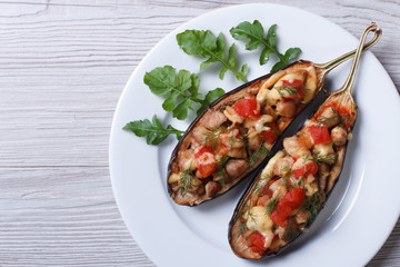 Stuffed aubergine with meat, cheese and tomatoes