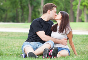 Young teen couple kissing at outdoor