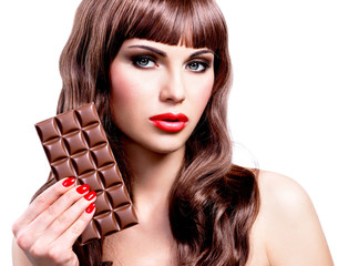Beautiful sexy woman with bar of chocolate.