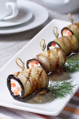 Eggplant rolls with cream cheese and tomatoes vertical