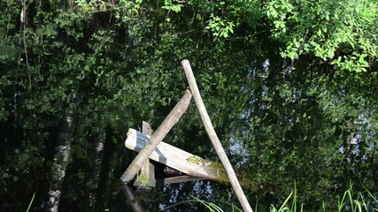 village pond collapsed old wooden small bridge