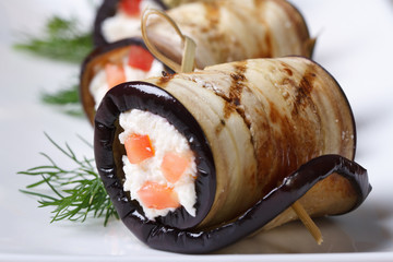 Eggplant rolls stuffed with cottage cheese and tomatoes