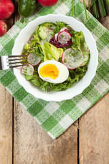 Salad with egg, radish and cucumber.