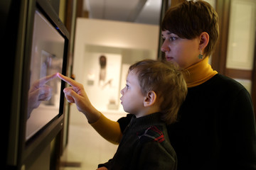 Mother and son using touch screen