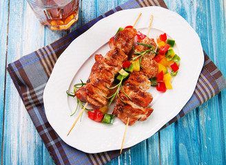 meat skewers, kebab with paprika vegetable salsa