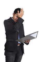 Asian businessman headache with a folder