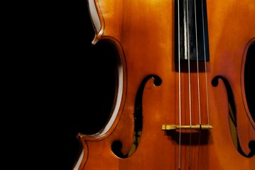 Cello orchestra musical instruments closeup on black