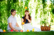 Beautiful Young Couple Having Fun. Picnic in Countryside. Happy
