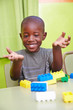 African boy playing in kindergarten