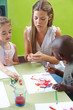 Children painting with tempera color in kindergarten