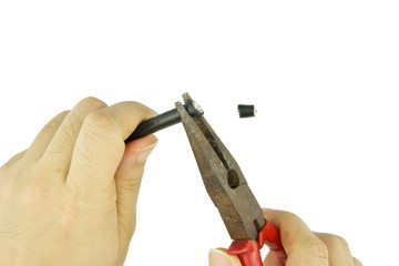 Man use old pliers to pinch cable line for repair isolated