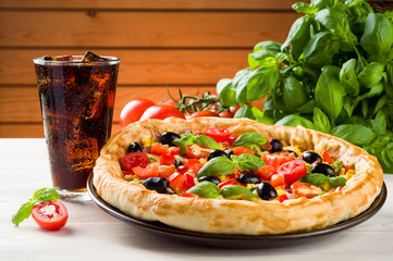 Pizza and coke on wooden table