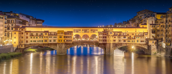 Night panoramic view of Vecchio Bridge, Florence