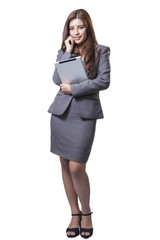 Young businesswoman standing holding digital tablet