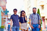 candid portrait of friends walking the city street