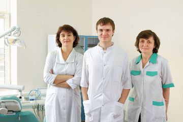medical doctors standing in dentist office