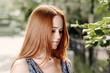 Young cute red haired women outdoors in calm state