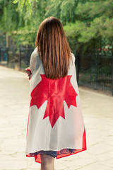 Women wrapped around with Canada nation flag