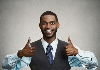 Happy corporate executive giving thumbs up gesture