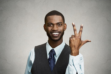 Company employee giving three times fingers gesture