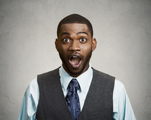 Shocked, unexpected surprised business man in happy disbelief