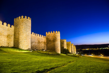 Scenic medieval city walls of Avila at night, Spain, UNESCO list