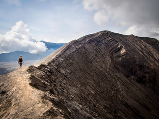 Hiker Walking Around Gunung Bromo Volcano in Java, Indonesia