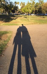shadow of a man with his arm around woman