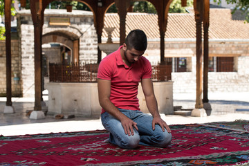 Prayer At Mosque Outdoors