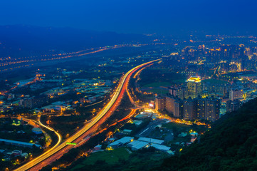night view of Taipei with traffic trails