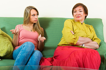 Mother with daughter talking seriously