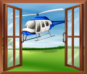 A window with a view of the chopper outside